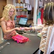 retailer giving card to customer