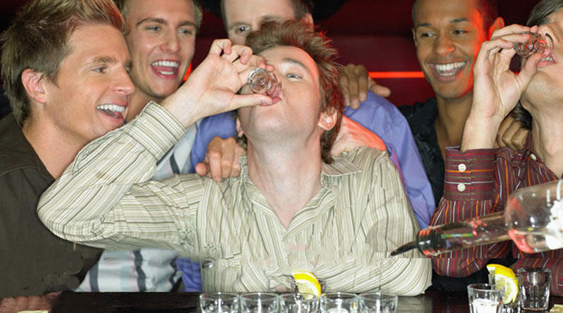 men drinking shots at bachelor party