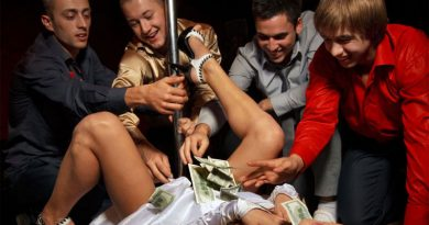 stripper with men giving cash