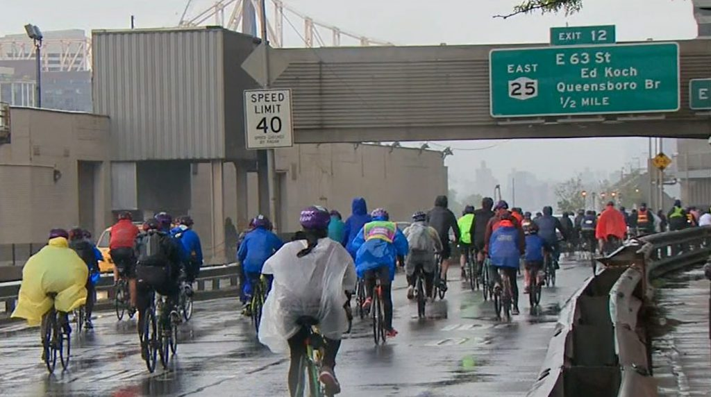 Five Boro Bike Tour at Queensborough Bridge during the rain